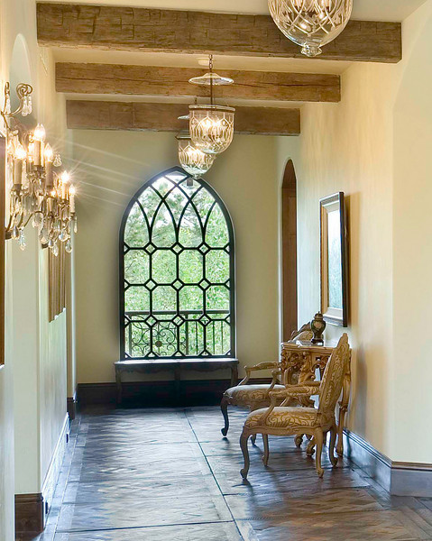 Custom designed high efficiency windows in this new, old-world home.