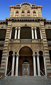 'Iolani Palace's Main Entrance  was restored to its 1886-1893 condition in the 1970s. Repairs have been integrated into the original structure without damaging the historical integrity of the Palace. Italianate architecture is well known for its romantic, lavish style and rich design details. Lanais (portico) surrounding the palace are  embellished with decorative brackets, motifs, cornice moldings above a frieze, and floral designs.