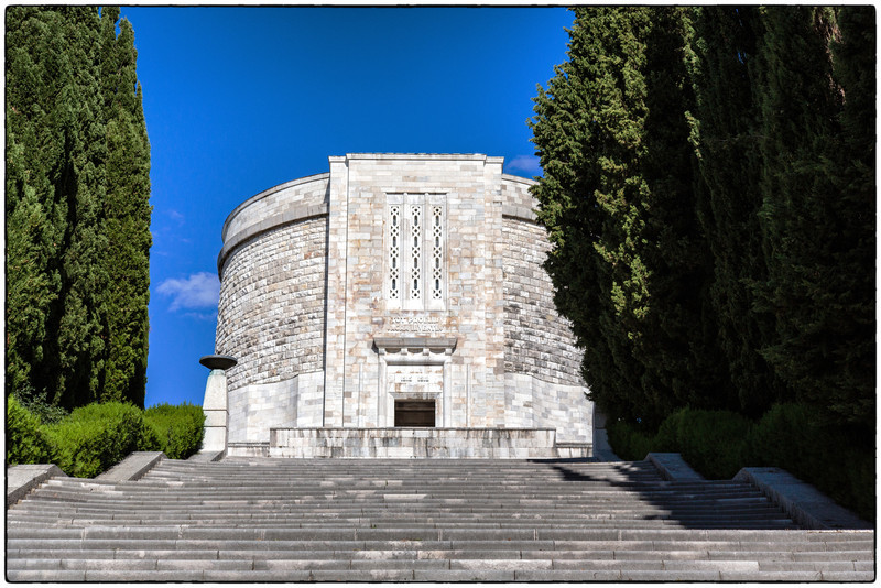 Sacrario di Oslavia 20Csociety Italy War Cemeteries trip  Oslavia is best known for the shrine dedicated to the fallen of the First World War . The shrine was built in 1938 and designed by Venturi Ghino and has an impressive central cylindrical white stone building, on the top of a staircase. It holds the remains of 57,741 soldiers, of whom about 36,000 persons unknown. The soldiers are for the vast majority Italians, but there are also buried 540 soldiers Austrians . Among the fallen Italians who are buried there are 13 gold medals , including General Achille Papa , who was killed at Bainsizza and buried at the center of the crypt.  For years, the shrine is facing extremely dilapidated condition and its stasis is at great risk, therefore, needs substantial renovations, but the Ministry of Defense does not have funds to restore.