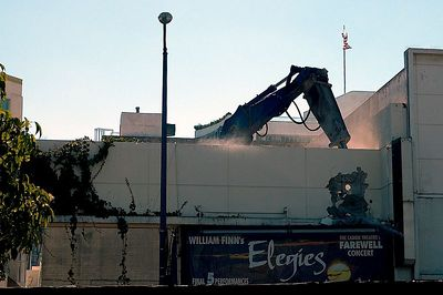 Moments before the crane extended its arm over the top of the facade, shifted into reverse, and pulled it down.
