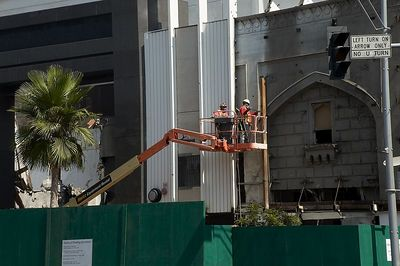 """Workers remove """"modern"""" facade to reveal original details of the Beverly Theater."""