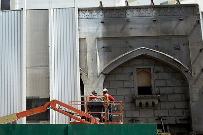"Workers remove ""modern"" facade to reveal original details of the Beverly Theater."