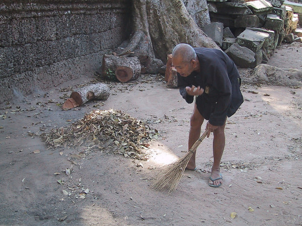 The elderly man that has tirelessly cleaned the interior of one of the temples for many years.