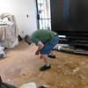 The old flooring has been ripped out and JC is picking up some stray flotsom