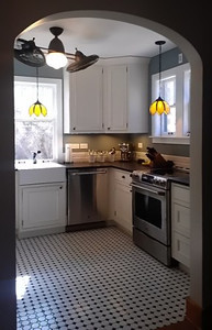 Classic detailing makes this Washington Park kitchen remodel fit with the rest of this 1924 home.
