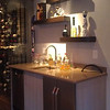 Basement bar with glass wine storage.  Love the floating shelves!