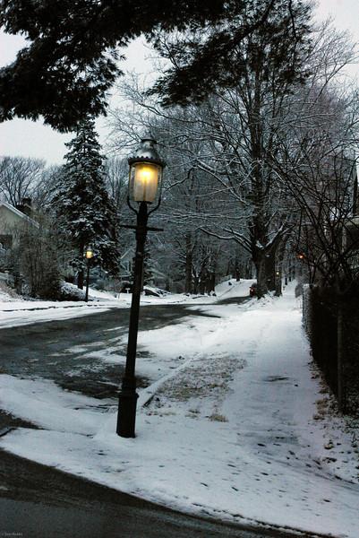 Three Gaslights on hill road.