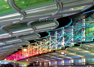 Chicago O'Hare has eaten its share of my time.  I figured I would at least try to get a photo of these neon things between terminal B and C.