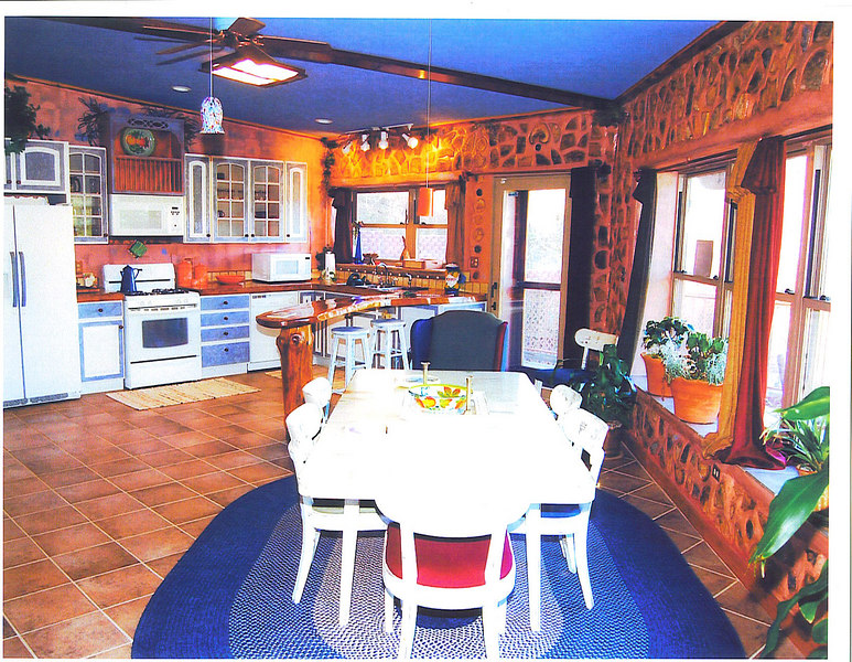 The kitchen and dining area are part of the great room.
