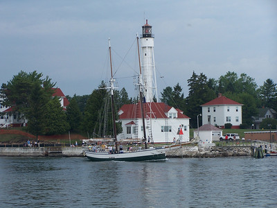 Madeline sailing past the Sturgeon Bay Coast Guard Station and lighthouse