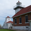 Sherwood Point Lighthouse and fog signal building. Looking out toward the waters of Green Bay.