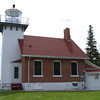 Sherwood Point Lighthouse:<br /> To the far right is the fuel storage building made of red brick with a red roof.