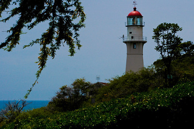 Diamond Head Lighthouse was built in 1917, is 147 feet above sea level. Diamond Head Light can be seen as far away as 18 miles and has an intensity of 60,000 candlepower. The light shows a red sector to warn vessels away from the reefs off Waikiki Beach.