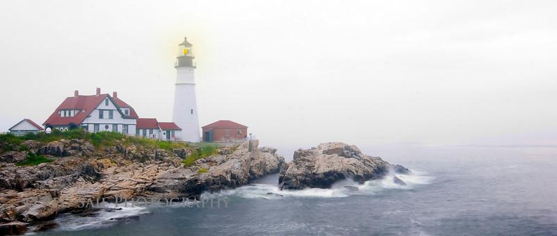 Portland Head Light. Portland, Maine. Foggy evening shot at a slow shutter speed creating a soft ocean look.