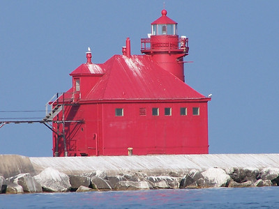 Big Red- Sturgeon Bay Ship Canal Pierhead. First built in 1882, the two-story steel fog signal building stands at the end of the North Pier, making the east entrance to the canal safe for seafaring travelers. Originally painted white, the structure was later painted red.
