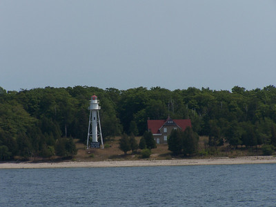 "Plum Island Lighthouse is located ""plumb"" in the middle of the treacherous Death's Door Passage between Lake Michigan and Green Bay, at the tip of the Door County peninsula of Wisconsin."