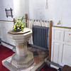 At the west end, the font. We were quite amused by the radiator screened either side with ecclesiastical type drapes.