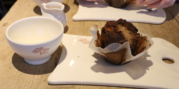 Tea cup empty and half eaten muffin at Le Pain Quotidien