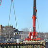 Walsh Construction is overseeing the demolition of the old University Ave., Bridge. Demo work is being done by Jr Vinagro Recycling & Demolition. Two large cranes are in place as they start to lift a one-third section of the bridge.  SUN/ David H. Brow