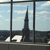 Tour of the new Lowell Justice Center with Clerk Michael Sullivan and project manager Jim Harding. In view from top floor, Eliot Church steeple is reflected in a window. (SUN/Julia Malakie)