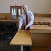 Tour of the new Lowell Justice Center.  Project manager Jim Harding at the attorney's lectern in a civil courtroom, showing where the attorney will be able to put a document on a reader and have it displayed on screens throughout the courtroom. (SUN/Julia Malakie)