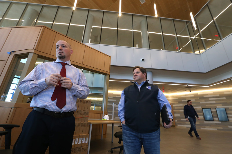 Tour of the new Lowell Justice Center with  project manager Jim Harding, left, and Clerk Michael Sullivan, in the main lobby.  (SUN/Julia Malakie)