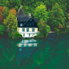 Slovenia / Europe<br /> <br /> This pic was taken from the top of a castle in Slovenia. The castle was on top of a hill with a lake on one side. Thos house was on the other side of the lake. surrounded by trees.