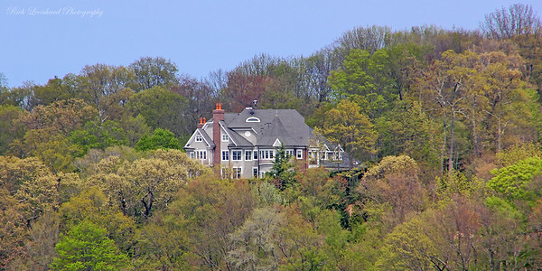 Mansion with Spring foliage in Cold Spring Harbor,NY. Note the Man standing on the roof.