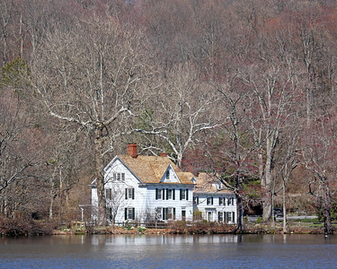 Mansion by pond in Cold Spring Harbor,NY.