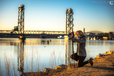 Steff Rahaim shooting video of Four Tree Island near Memorial Bridge at sunset