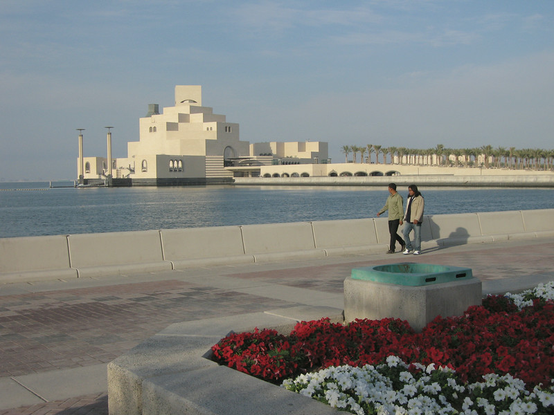 Strollers on the Corniche enjoy the Museum of Islamic Art in Doha, Qatar.