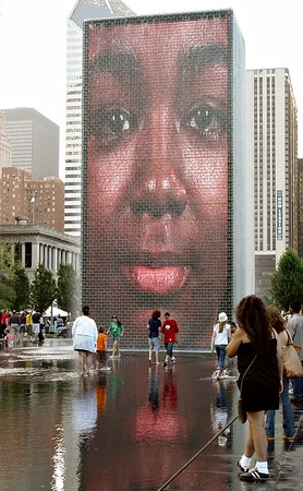 It's interesting that faces of Chicagoans are shown on these huge screens.  I wonder if they've all come to the park to see themselves already?