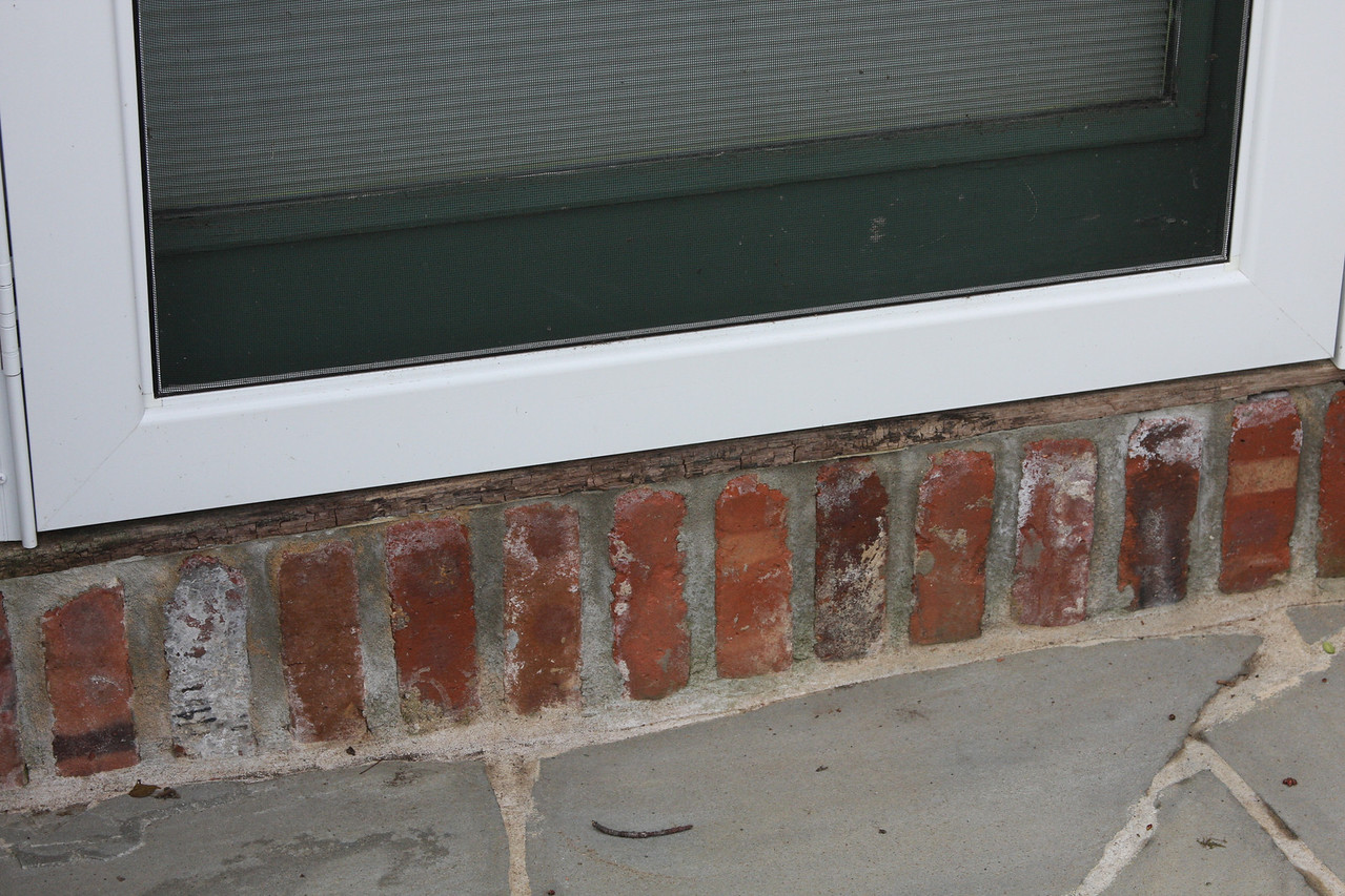 door behind garage sill rotten