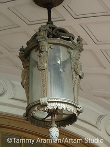 hanging light fixture above Commerce High portico