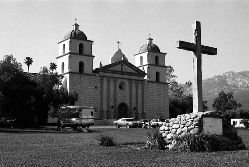 MISSION SANTA BARBARA<br /> Santa Barbara, California<br /> <br /> Mission Santa Barbara -- also known as Santa Barbara Mission -- is a Spanish Franciscan mission near present-day Santa Barbara, California. It was founded on December 4, 1786, the feast day of Saint Barbara, as the tenth mission for the religious conversion of the indigenous local Chumash -- the Barbareño tribe of Native American people. The Mission grounds occupy a rise between the Pacific Ocean and the Santa Ynez Mountains, and were consecrated by Father Fermín Lasuén, who had taken over the presidency of the California mission chain upon the death of the chain's founder, Father Presidénte Junípero Serra. Mission Santa Barbara is the only mission to remain under the leadership of the Franciscan Friars since the day of its founding.