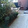 Tuin en terras aan keukenzijde