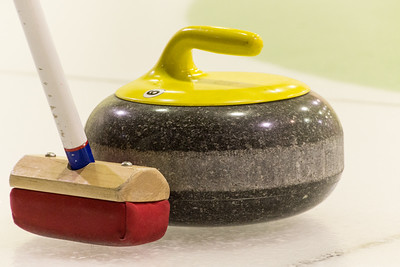 curling stone and broom, Churchill, Manitoba, Canada