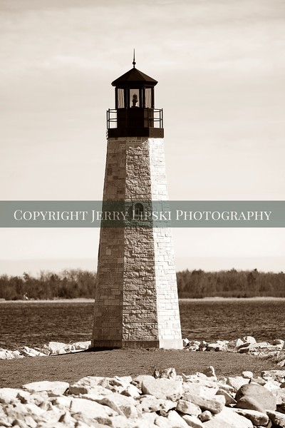 Image 6................Small lighthouse in sepia tones.    A smaller structure stands in the bay at Menominee Wisconsin.