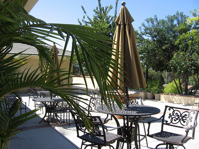 Cool outdoor patio, with a great view of the surrounding area, in front of the food distribution area.