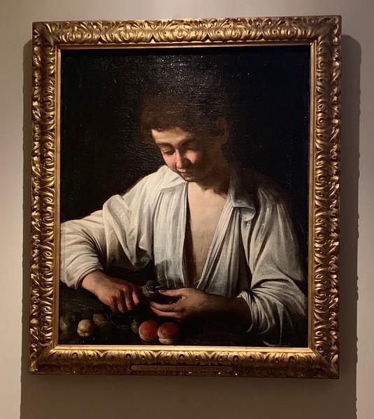 Boy Peeling Fruit - Caravaggio