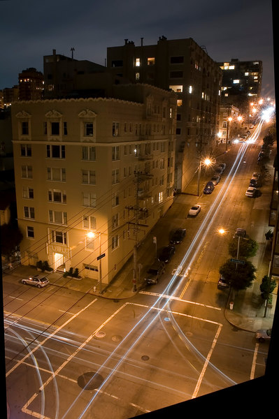 At night, the street glows with the lights of passing cars and taxis. This was a 156-second exposure.