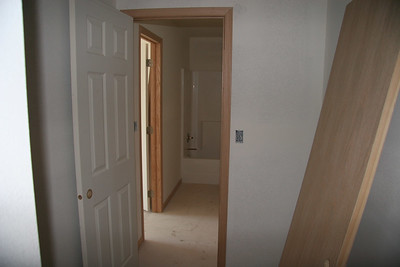 Look into the master bath from the closet