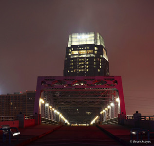 Looking toward the Pinnacle Tower from the Shelby Street pedestrian bridge at about 6:19am on a foggy Saturday morning in downtown Nashville, TN.