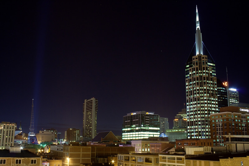 "Nashville skyline with a beam of light from in  front of the Gaylord Arena.  The ""bat building"" (AT&T building) looks really different with the spires lined up."