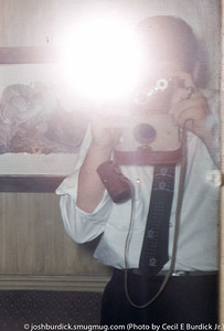 Dad taking a self portrait with his Argus C3 in July 1956