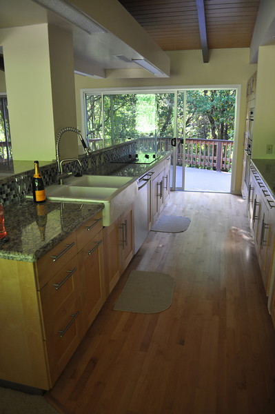 Aug 2011. Kitchen redone by previous owners, including the small planked hardwood floors. We ended up ripping out their floors and the carpet, so we could have the entire living space and kitchen matching.