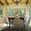 """Feb 2012. Walking into the front door, this is a view from the floor at the table, dining table light, and doors to back deck.<br /> <br /> It is 42"""" from bottom of light to top of table. It is 78"""" from beam to top of table."""