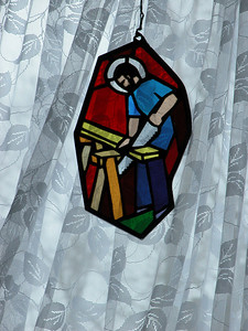 This is a stained glass hanging in the bedroom window with a lace curtain behind it.  I like the colors and that you can see the curtain texture through the glass.  No exposure correction, naturally backlit from overcast 11AM light and snow reflection.