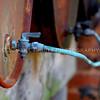Copper Tubing and Rusty Barrels
