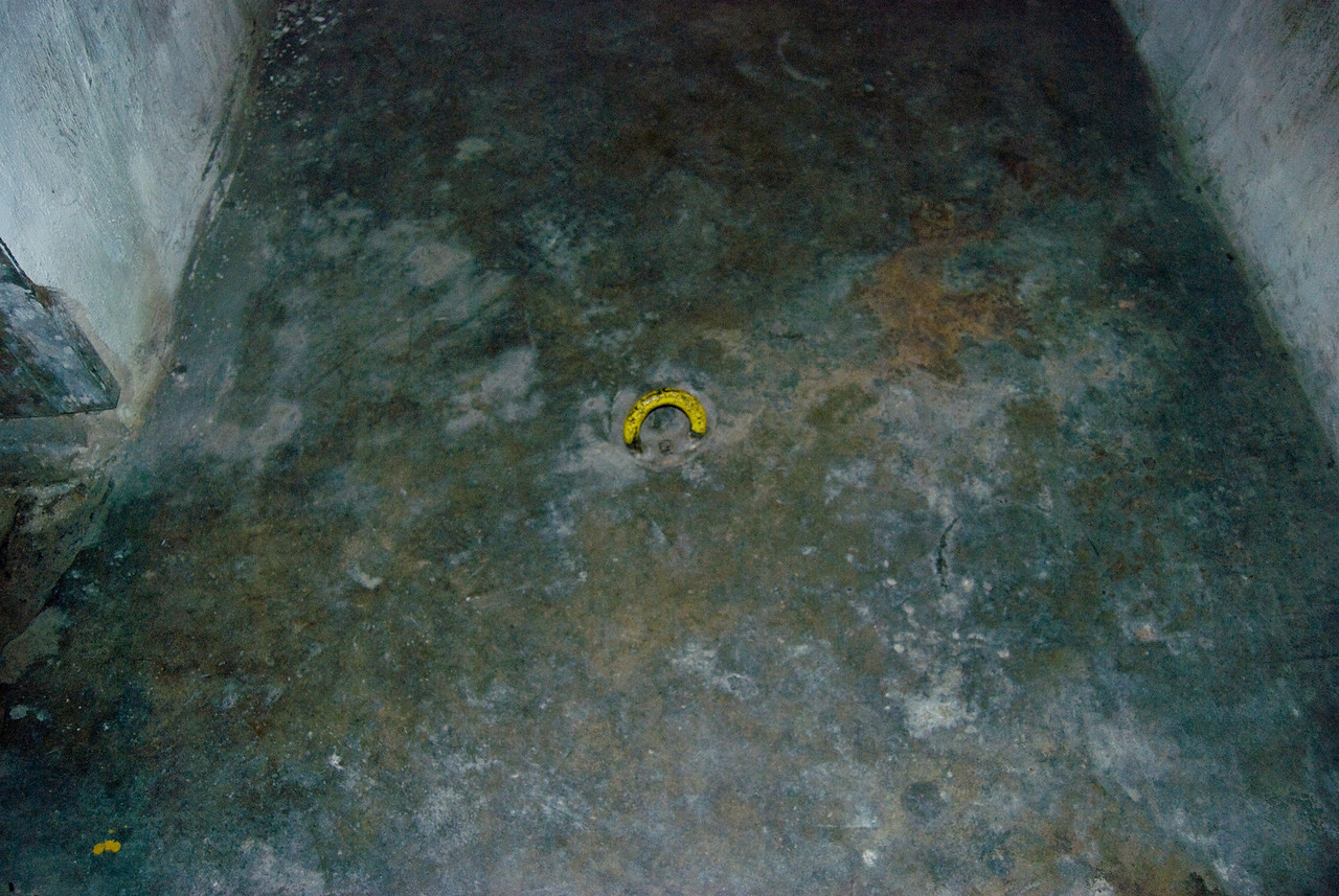 This ring in the floor was used to chain the prisoners to.
